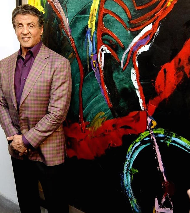 Stallone poses with one of his paintings